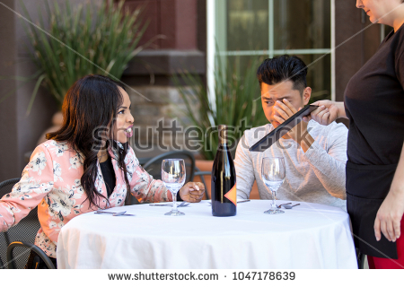 stock-photo-couple-on-a-date-angry-at-a-waitress-in-an-outdoor-restaurant-they-are-upset-and-dissatisfied-1047178639